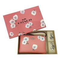 【COACH】展示品花卉印花手拿零錢包(粉)